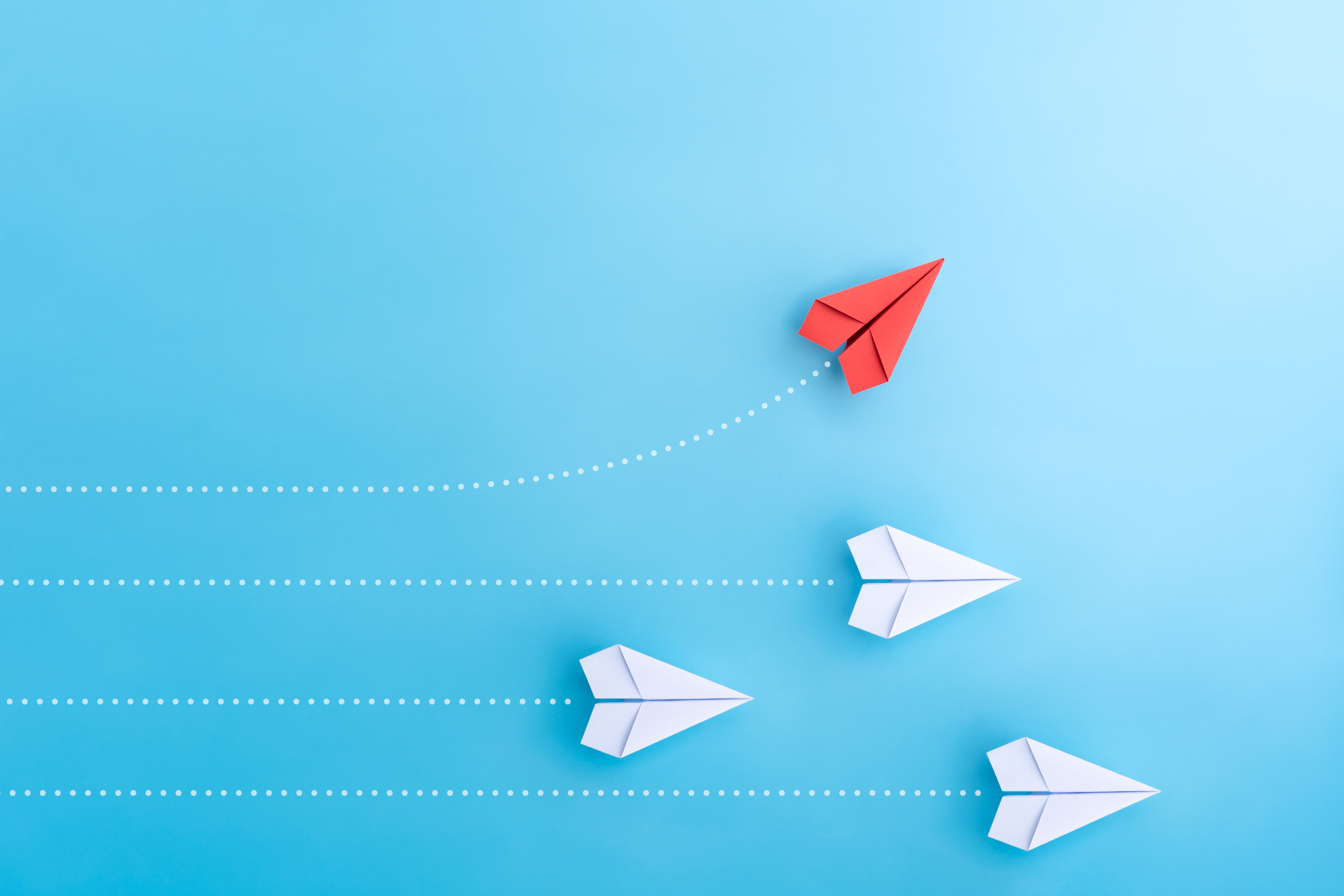 Group of paper plane in one direction and with one individual pointing in the different way. Business concept for new ideas creativity and innovative solution.